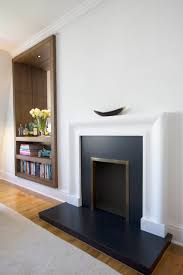 fireplace with concealed bookshelves barnaby reynolds