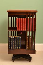 decorating revolving bookcase with white wall decor for modern