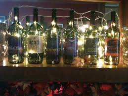 halloween mantel decor with empty wine bottles fun labels from