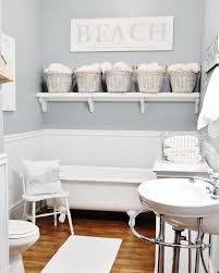 themed shelves themed bathroom with pale blue colors also floating wall