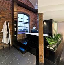 bathroom an excellent bathroom with black tile flooring and