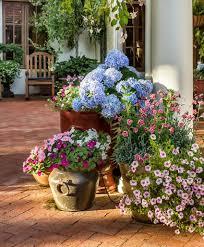 artificial flowers in patio pots home improvement pinterest