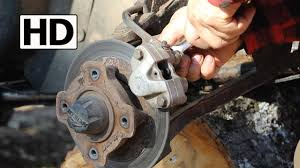 how to change atv brake pads arctic cat 500 youtube