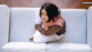 alizee jacotey siting on sofa and looking front hd wallpaper