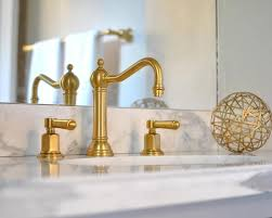 bathroom faucet ideas glam bathroom features a washstand with topped with honed gray and