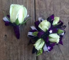 purple corsage white wrist corsage with purple ribbon with matching