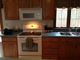 what wall color looks with oak cabinets what color walls oak cabinets and blue green countertops