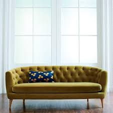 green tufted curved sofa