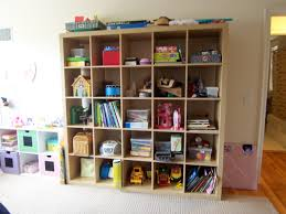 furniture cream ikea expedit bookcase filled with books and toys