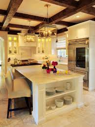 this open old world style kitchen features a beautiful marble