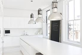 resolution 4 architecture designed this white bright light the modern kitchen was situated around the corner from the apartment entrance like the rest of the apartment it s clean and white with a few bold accents