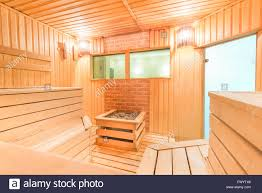 steam room wooden finnish sauna with stones stock photo royalty