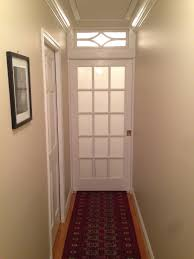 Frosted Glass Bedroom Doors by Frosted Glass Pocket Door And Transom Bisects Long Hallway And
