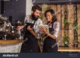 blue martini waitress waitress using tablet computer waiter coffee stock photo 573964450
