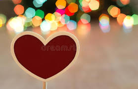 heart shaped christmas lights heart shaped board with christmas lights in background stock image
