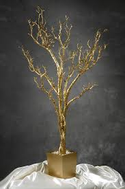 4 foot gold clitter artificial tree in wood pot with white stones