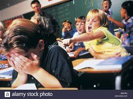 classmates search fl2785 mad cow studio boy jeered by classmates stock photo
