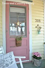 my farmhouse porch is anxious for spring farmhouse front