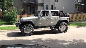 white jeep wrangler 4 door black rims 30