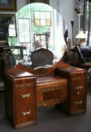 vintage 1940s vanity w large round mirror with four drawers and a