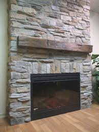 gray stacked stone wall fireplace ideas come with wall mount wood