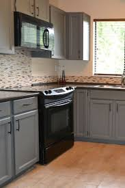 kitchens with black appliances and oak cabinets black appliances and white or gray cabinets how to make it work