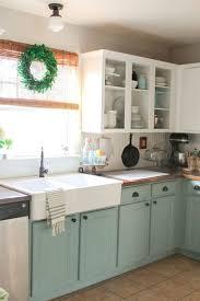 cherry wood sage green prestige door open cabinets in kitchen