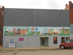 high school mural class creates community art sdpb radio the 48 feet by six feet painting hosts images important to milbank s history and culture baseball corn stalks and a dairy farm the national guard unit