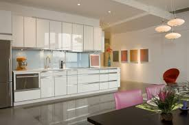 single line of white kitchen with mounted cabinet and island baby