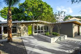 mid century modern homes exterior concrete flooring with plants and glass windows plus
