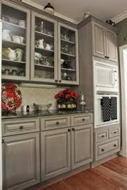Black Countertop Kitchen - stunning kitchen features white upper cabinets and gray lower
