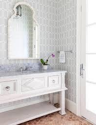 gray powder room with terracotta arabesque floor tiles