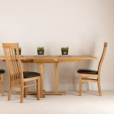 extending pedestal dining table quercus solid oak extending pedestal dining table con tempo furniture