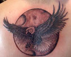 nice flying eagle with moon tattoo design make on upper back