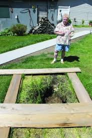 Sinkhole In Backyard How Deep Is It Butte Homeowner Watches Sinkhole Grow In Back Yard