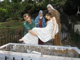 where do you put a st thetouching caption of jesus being put into the tomb picture of