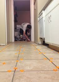 How To Tile Kitchen Floor by Tiling The Kitchen Floor Planitdiy