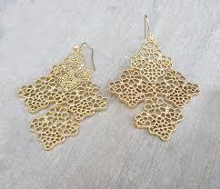 gold earrings in shape gold dangle earrings gold earrings statement earrings gold