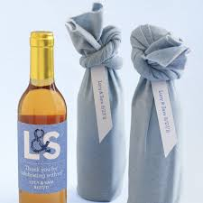 wine bottle favors fabric wrapped wine wedding favor martha stewart weddings