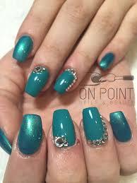fluid nail design acrylic nails with teal polish and diamonties