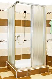 interior of shower cabin with brown tiles stock photo picture and