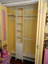 kids yellow wooden closet organizer with white drawers and shelves