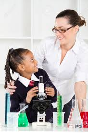 Photography Teacher Friendly Teacher Talking To Elementary Student In Science Class