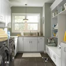 Space Saving Laundry Ideas White by A Snazzy Blend Of Sewing Room And Laundry In Small Space Laundry