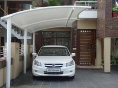 Small Car Ports A Cantilevered Awning Is The Perfect Solution To This Small Car
