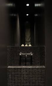 innovative dark tile sink along near dark wall inside surgery de