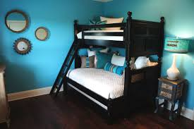 Bunk Bed Sheet Black Wooden Bunk Bed With White Bed Sheet And Blue Pillows Also