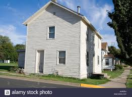 old two story small white house rural town benton wisconsin stock