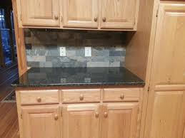 uba tuba granite countertops kitchen eclectic with backsplash