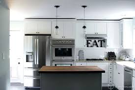 off white kitchen cabinets with stainless appliances white cabinets black appliances black appliances and white or gray